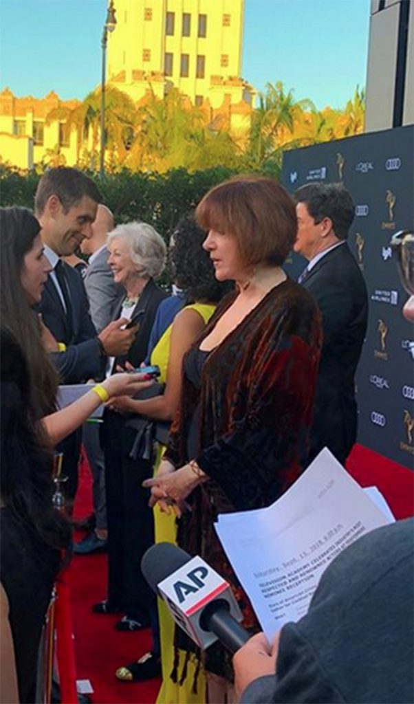 Lee Garlington being interviewed on the red carpet.