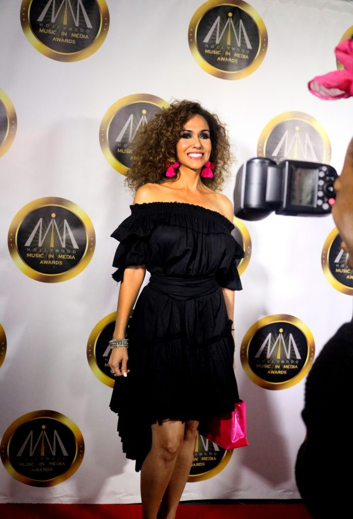 Estani Frizzell on the red carpet at the Hollywood Music in Media Awards
